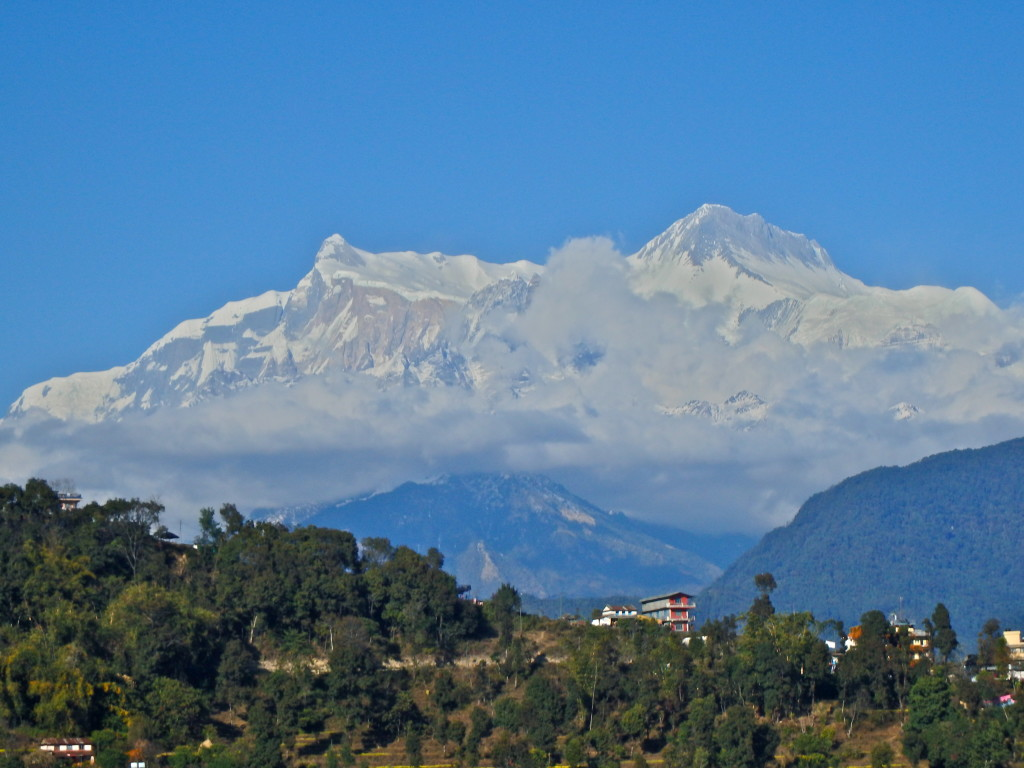 Annapurna Range from Pokhara, Nepal, from the air where is the best place to see the himalayas best places to hike in nepal where to go in nepal for solo females
