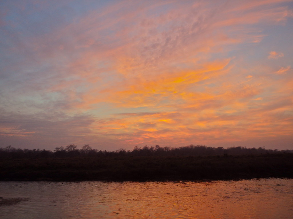 Sunset over Chitwan jungle nepal where to visit in nepal what to do in chitwan nepal best places to travel in nepal